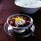 Rice pudding with warm berry sauce (Christmas dessert, Sweden)