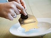 Slicing a black truffle