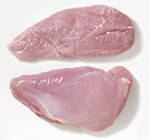 Two raw turkey breast fillets
