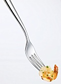 A prawn on a fork