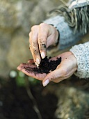 Woman with compost in her hands