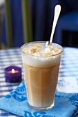 Café au lait in glass on table