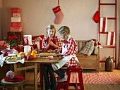Two girls baking for Christmas