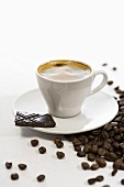 Cup of coffee, chocolate and coffee beans
