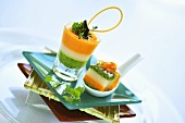 Vegetable terrine with salmon cream in glass and on spoon