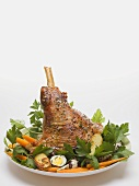 Lamb shank with quails' eggs, carrots and parsley for Easter