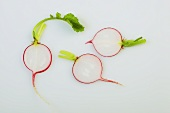 Three slices of radish with leaves