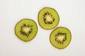Three slices of kiwi fruit