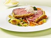 Roast beef with cheese crust and vegetables