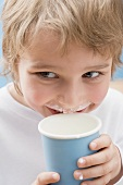 Little boy with milk round his mouth