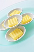 Portions of butter in small dishes