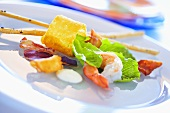 Lettuce with prawn, ham, potato crisp and garlic dip