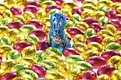 Small chocolate eggs in coloured foil, chocolate Easter Bunny