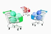 Easter eggs in miniature shopping trolleys
