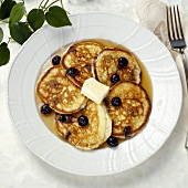 Plate of Blueberry Pancakes with Syrup and Butter