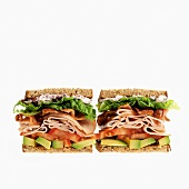 Two Turkey Sandwiches with Bacon,Tomato and Avocado