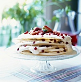 Pancake cake filled with berries and cream (close-up)