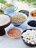 Assorted pulses and dried fruits in bowls