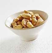Shelled cashew nuts in ceramic bowl
