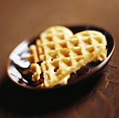 Heart-shaped waffle in brown dish