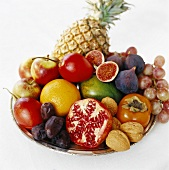 Plate of fruit with walnuts