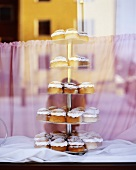 Cream buns on tiered stand in shop window