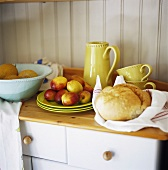Bread and apples on kitchen cabinet