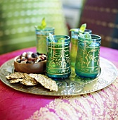 Peppermint tea and snacks on silver tray