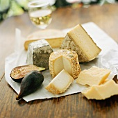 Various cheeses and fig