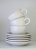 White coffee cups and saucers (stacked)