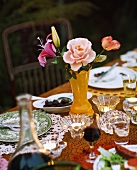 A table that has been set with wine, tee lights and flowers