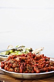 Crayfish and salad on a wooden table at the beach