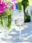White wine glass on a summer table
