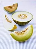 Various types of melon on checked fabric