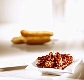 Dried tomatoes in a small dish