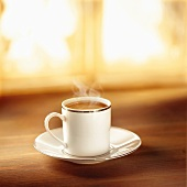 Coffee in silver-rimmed cup and saucer