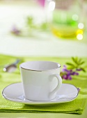 White cup and saucer with silver rim, lavender