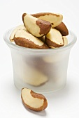 Several Brazil nuts in a glass