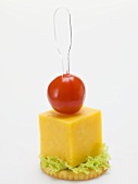 Cheese and cherry tomato on cracker
