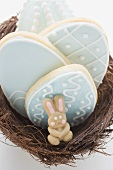 Biscuits and marzipan rabbit in Easter nest