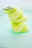 Peeled and sliced Thai cucumbers with fork