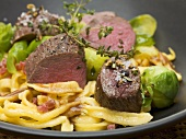 Loin of venison with spaetzle (noodles), bacon & Brussels sprouts