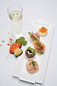 Canapés, glass of sparkling wine, good luck charms for New Year