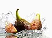 Fresh figs with splashing water