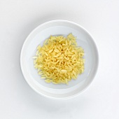 A plate of long grain rice, seen from above