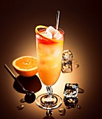 Lychee cocktail with rum, liqueur, orange and grapefruit juice