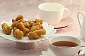 Koeksisters (South African fried dough plaits) with tea