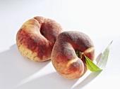 Two vineyard peaches