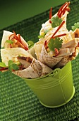 Chicken wraps with pepper strips and coriander