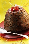 Plum pudding with candided fruits